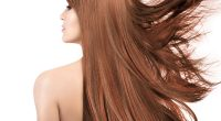 Beauty model with gorgeous long hair with highlights. Coloring t